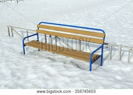 Wooden Light Bench With A Metal Blue Base On A Snow Background. City Landscape, Recreation Area. Sto
