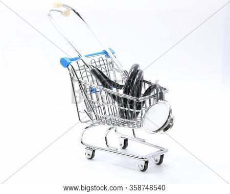 Really Very Small Shopping Trolley With A Large Stethoscope On The White Background