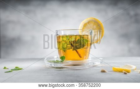 Glass Cup Of Mint Tea With Leaves And Lemon