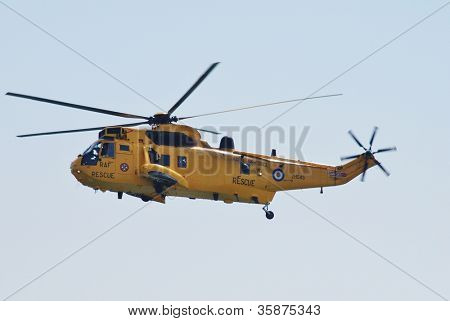 EASTBOURNE, ENGLAND - AUGUST 11: A Westland Sea King HAR3 helicopter of the RAF Search and Rescue squadron, performs at the Airbourne airshow on August 11, 2012 at Eastbourne, East Sussex.