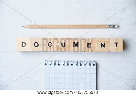 Modern Business Buzzword - Document. Top View On Wooden Table With Blocks. Top View. Close Up.