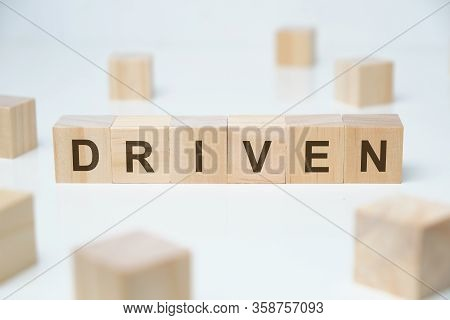 Modern Business Buzzword - Driven. Word On Wooden Blocks On A White Background. Close Up.