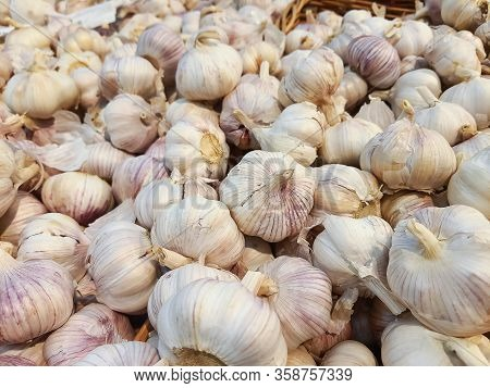 Close Up Of Garlic Background.fresh Garlic On Market Table Closeup Photo. Vitamin Healthy Food Image
