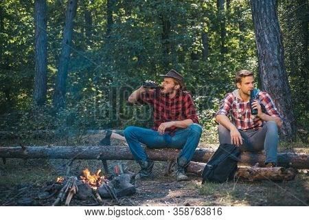 Two Friends Guy Camping In Forest. Spring Or Autumn Camping. Happy Young Friends Having Picnic In Th