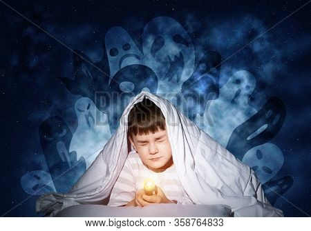 Scared Boy Hiding Under Blanket From Imaginary Spooky Monsters. Fearful Kid With Closed Eyes Lying I