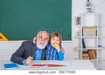 Portrait Of Grandfather And Son In Classroom. Student And Tutoring Education Concept. Grandfather An