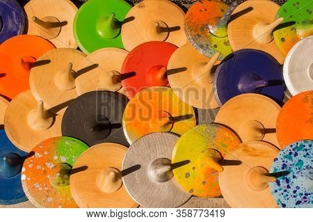 Wooden Peg Tops Or Whirligigs As Background