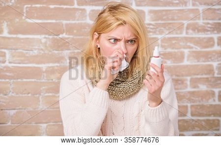 Keeping The Medication In Her Nose. Suffering From Asthma Or Allergic Rhinitis. Sick Woman With Nose