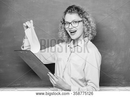 Read Impressing Resume. Tutor Checking Homework. Woman Smart Lady Hold Tablet Documents. Read Person