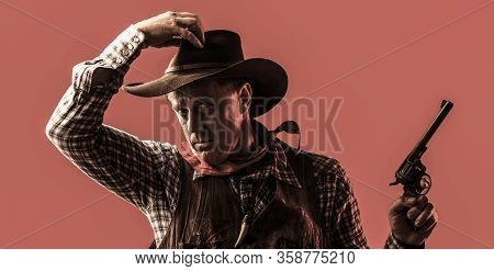 West, Guns. Portrait Of A Cowboy. Portrait Of Farmer Or Cowboy In Hat. American Farmer. Portrait Of