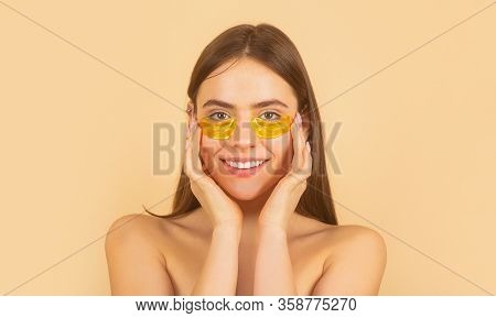 Woman Applying Golden Eye Patches. Close Up Portrait Girl. Portrait Of Beauty Woman With Eye Patches