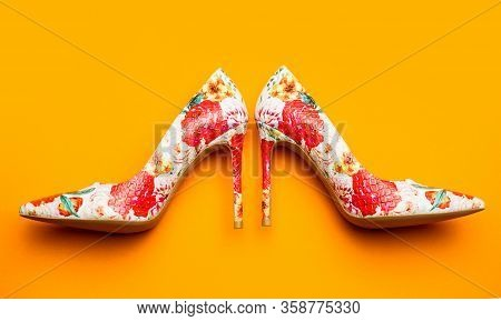 Stylish Female Shoes In Colors. Fashionable Women Shoes. Colored Women Shoes On Yellow, Orange Backg