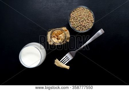 Soy Products Soy Tofu Leather Soy Milk In Glass Jars And A Glass On A Dark Slate Background With Pla