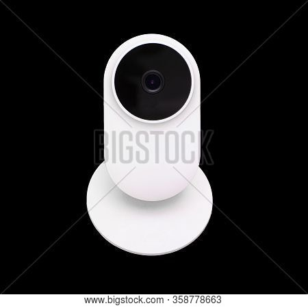 White Compact Ip Wifi Camera For Home Use Isolated Over Black Background