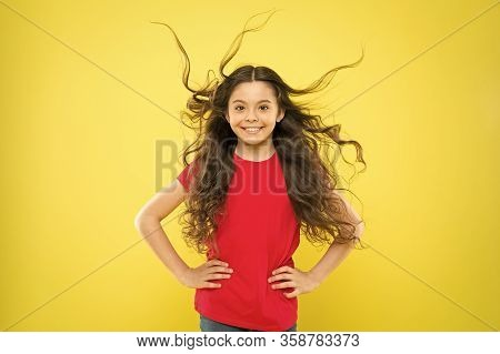Wind Can Also Damage Hair. Girl Adorable Kid Long Wavy Hair Yellow Background. Things You Doing To D