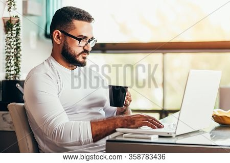 Young Man Working From Home On His Laptop