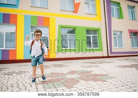 Back To School. Happy Smiling Boy In Glasses Is Going To School For The First Time. Child With Backp