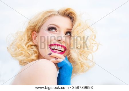 Pin-up Retro Girl With Curly Hair Winking, Smiling And Showing Ok Sign. Presenting Your Product. Exp