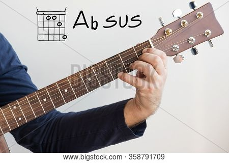 Learn Guitar - Man In A Dark Blue Shirt Playing Guitar Chords Displayed On Whiteboard, Chord Chord A