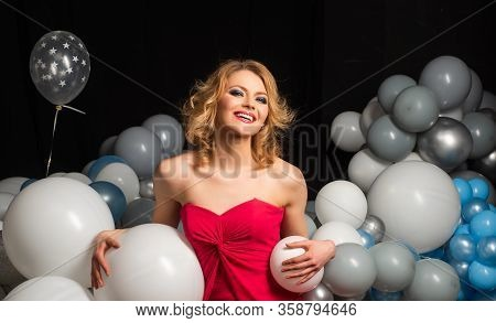 Lady In Red. Beautiful Smiling Woman With Balloon. Celebrating New Year, Christmas, X-mas, Birthday,