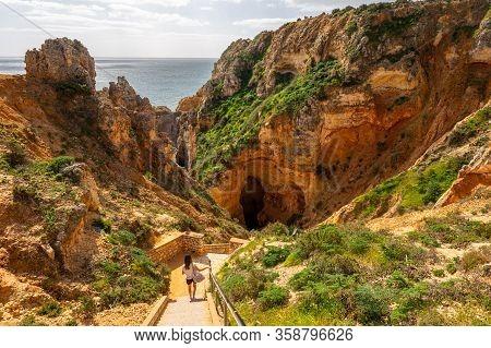 Lagos, Portugal - 6 March 2020: Tourist Visiting Ponta Da Piedade