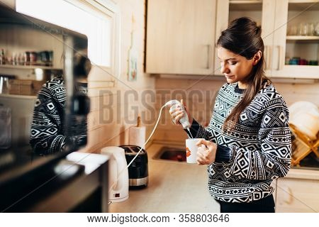 Woman Making Coffee Drink At Home Kitchen Using Electric Milk Frother Drink Mixer Coffee Whisk For F