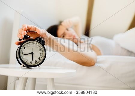 Alarm Clock Ringing.woman Waking Up In Early Morning For Work.sleeping Disorder.tired Woman Overslee