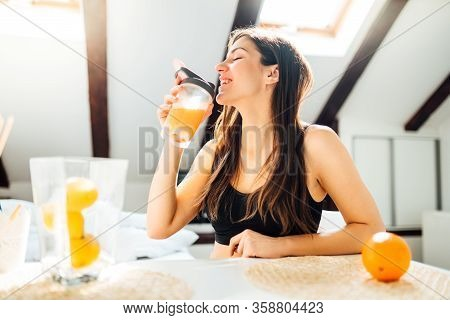 Woman At Home Drinking Orange Flavored Amino Acid Vitamin Powder.keto Supplement.after Exercise Liqu