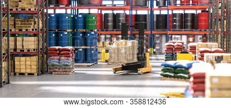 industrial interior of a warehouse with pallets and different goods. 3d render. nobody around, landscape format.