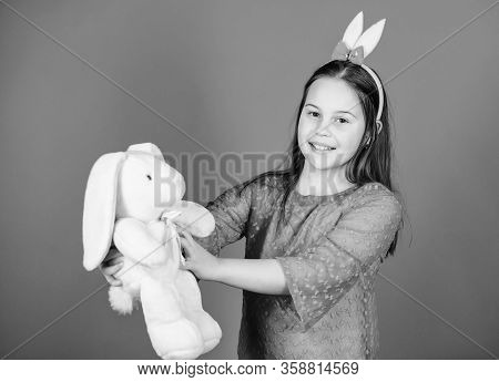 Happy Childhood. Bunny Ears Accessory. Lovely Playful Bunny Child Hugs Soft Toy. Bunny Girl With Cut