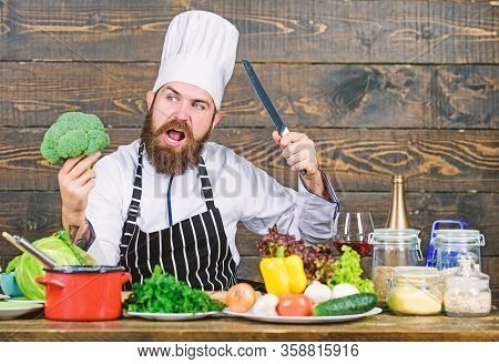 My Kitchen My Rules. Man Bearded Hipster Cooking Fresh Vegetables. Freshest Possible Ingredients. Ch
