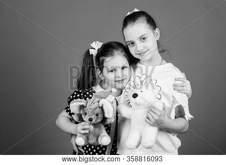 Kids Adorable Cute Girls Play With Soft Toys. Happy Childhood. Child Care. Sisters Or Best Friends P