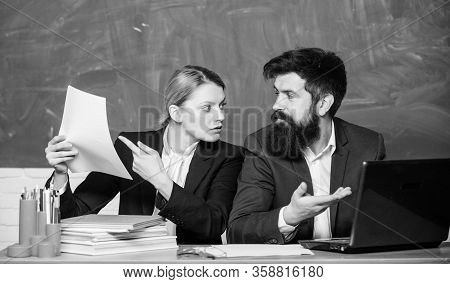 Prepare For School Lesson. Teacher And Supervisor Working In School Classroom. School Educator With