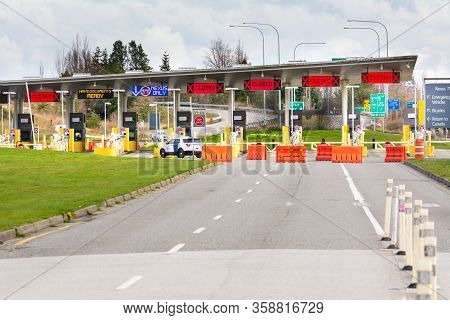 Surrey, Canada - Mar 29, 2020: Barricades And Empty Car Lanes On Approach To Closed Usa Border Stati