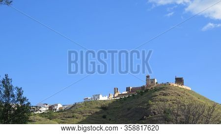 View Of Alora Arabic Castle And Church Tower In Early Morning Sunshine, Andalusia, Spain