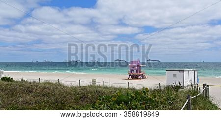 Empty South Beach In Miami Beach, Florida Under Coronavirus Pandemic Beach Closure With Cruise Ships