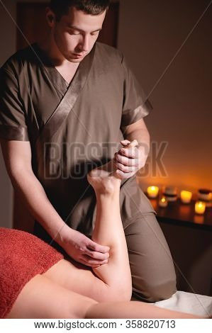 Premium Male Luxury Shin Massage Anti-cellulite Wellness Complex. Male Masseur Doing Leg Massage To