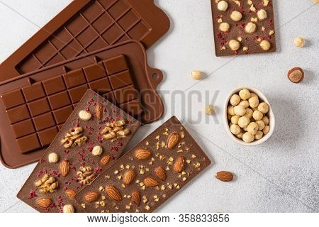 Homemade Milk Chocolate Bars With Nuts And Dried Fruits In Molds. Chocolatier, Confectionery. Top Vi
