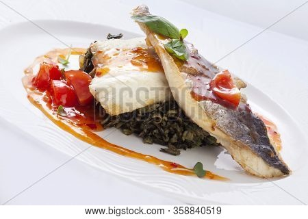 Fried Dorado Fillet With Wild Rice On A White Background