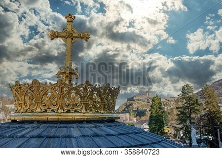 Golden Cross And Crown In Lourdes, France, Hautes Pyrenees. Basilica Of Our Lady Of The Rosary