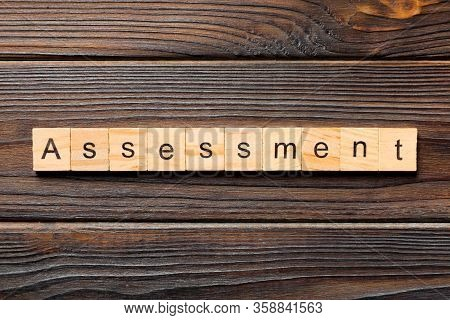 Assessment Word Written On Wood Block. Assessment Text On Table, Concept