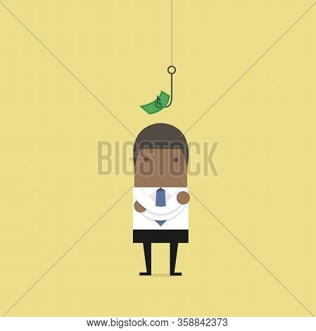 African Businessman Standing In Front Of A Hook With A Dollar Sign As Bait.