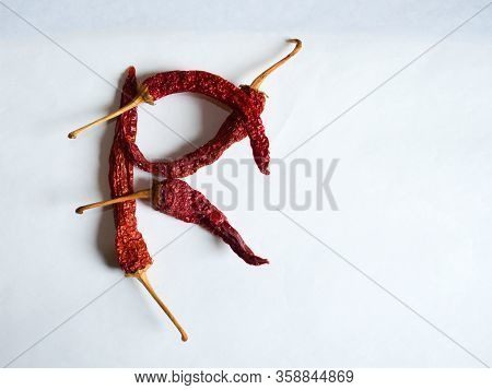 Letter R Lined With Red Peppers On A White Background. Symbol In The Form Of The Letter R. Pepper Li