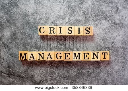 The Letters On The Wooden Blocks That Write The Word Crisis Management On The Black Cement Backgroun