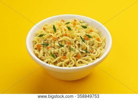 Bowl Of Instant Noodles Isolated On Yellow Background
