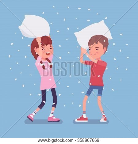Pillow Fight Game, Boy And Girl Kids Enjoy Free Time At Home. Sleepover Fun, Pajamas Party Or Slumbe