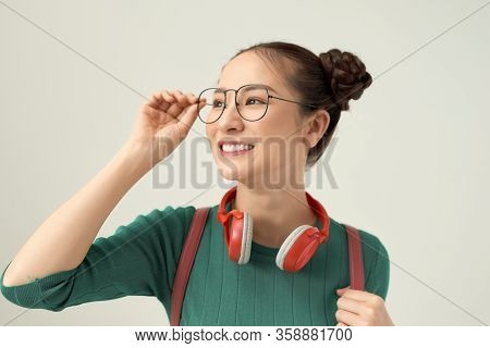 Young Asian Woman Wear Eyeglasses Beautiful Student With Bag.