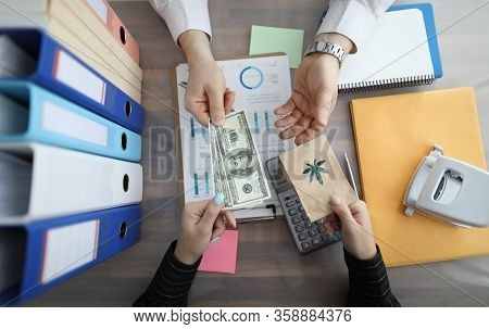 Top View Of Female Hands Paying Money Cash For Medical Cannabis In Paper Bag. Businessman Making Bar