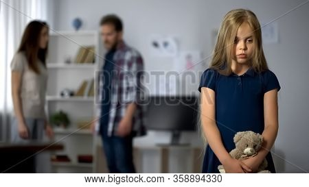 Upset Girl Witnessing Act Of Domestic Violence, Suffering From Parents Conflicts