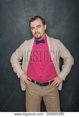 Funny Teacher Man Or Businessman With Eyeglasses On Blackboard Background
